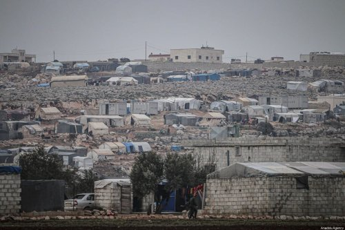 General view of a makeshift camp populated by Syrian families, who have been forcibly displaced due to the ongoing attacks carried out by Assad regime and its allies, in Turmanin in the western rural of Aleppo near Turkish border on a cold winter day in Idlib, Syria on 14 February 2020. [Muhammed Said - Anadolu Agency]