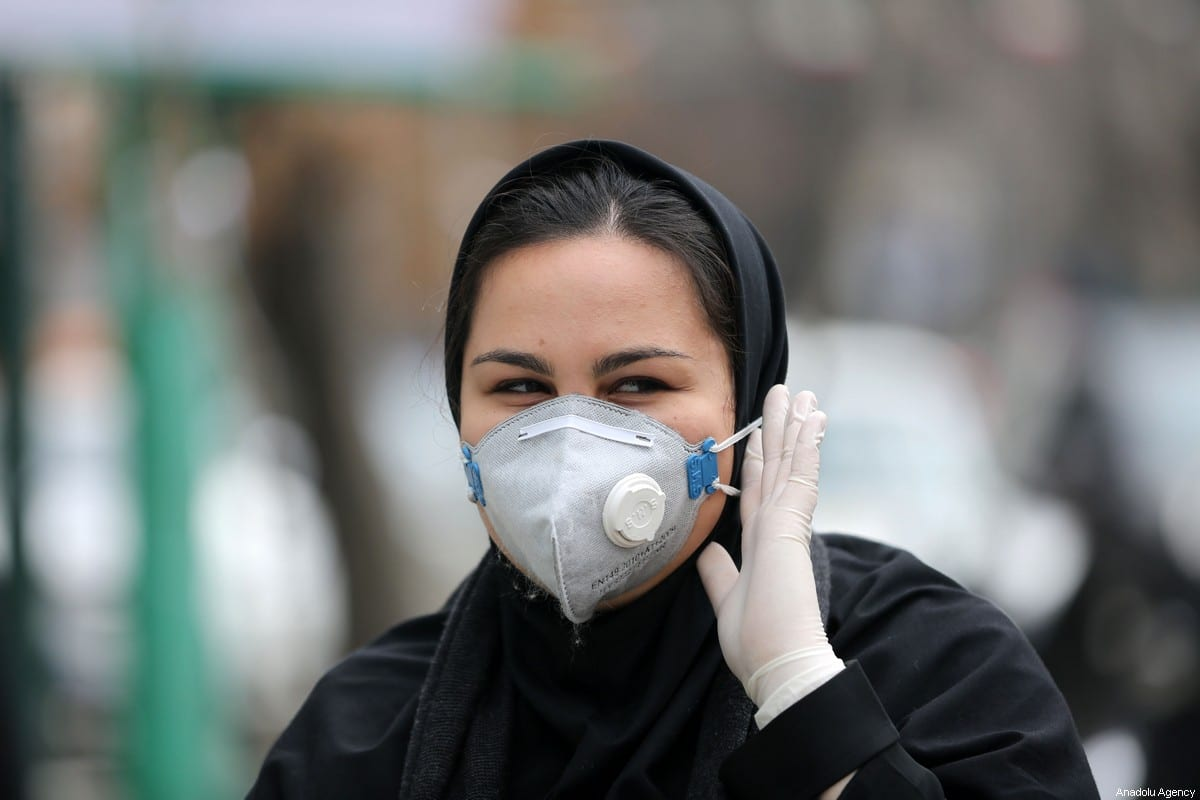 People wear masks after deaths and new confirmed cases revealed from the coronavirus in Tehran, Iran on February 21, 2020 [Fatemeh Bahrami/Anadolu Agency]
