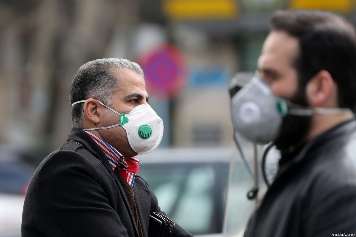 People wear masks after deaths and new confirmed cases revealed from the coronavirus on 21 February 2020 [Fatemeh Bahrami/Anadolu Agency]