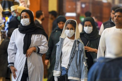 People wear medical masks as a precaution against coronavirus in Kuwait City, Kuwait, on 26 February 2020 [Jaber Abdulkhaleg/Anadolu Agency]