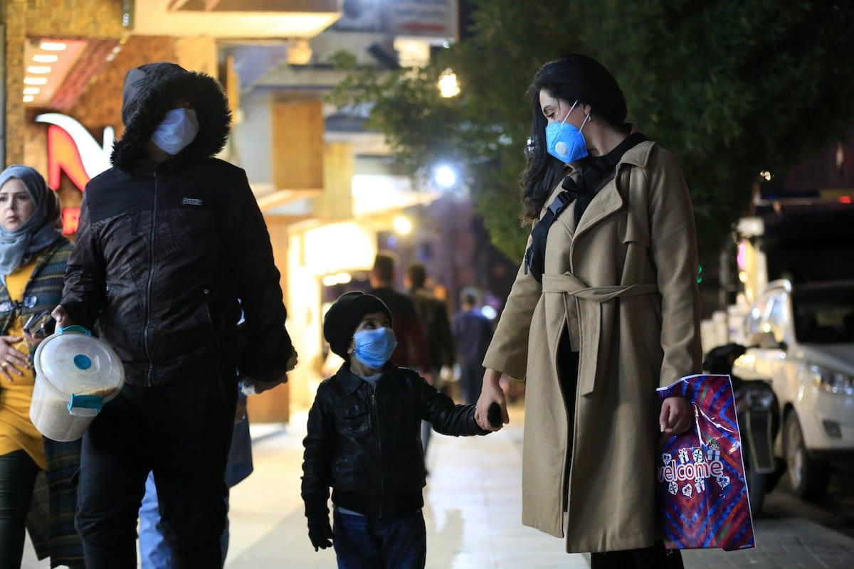 Citizens wear medical masks as a precaution against coronavirus (COVID-19) on 26 February 2020 in Baghdad, Iraq. [Murtadha Al-Sudani - Anadolu Agency]