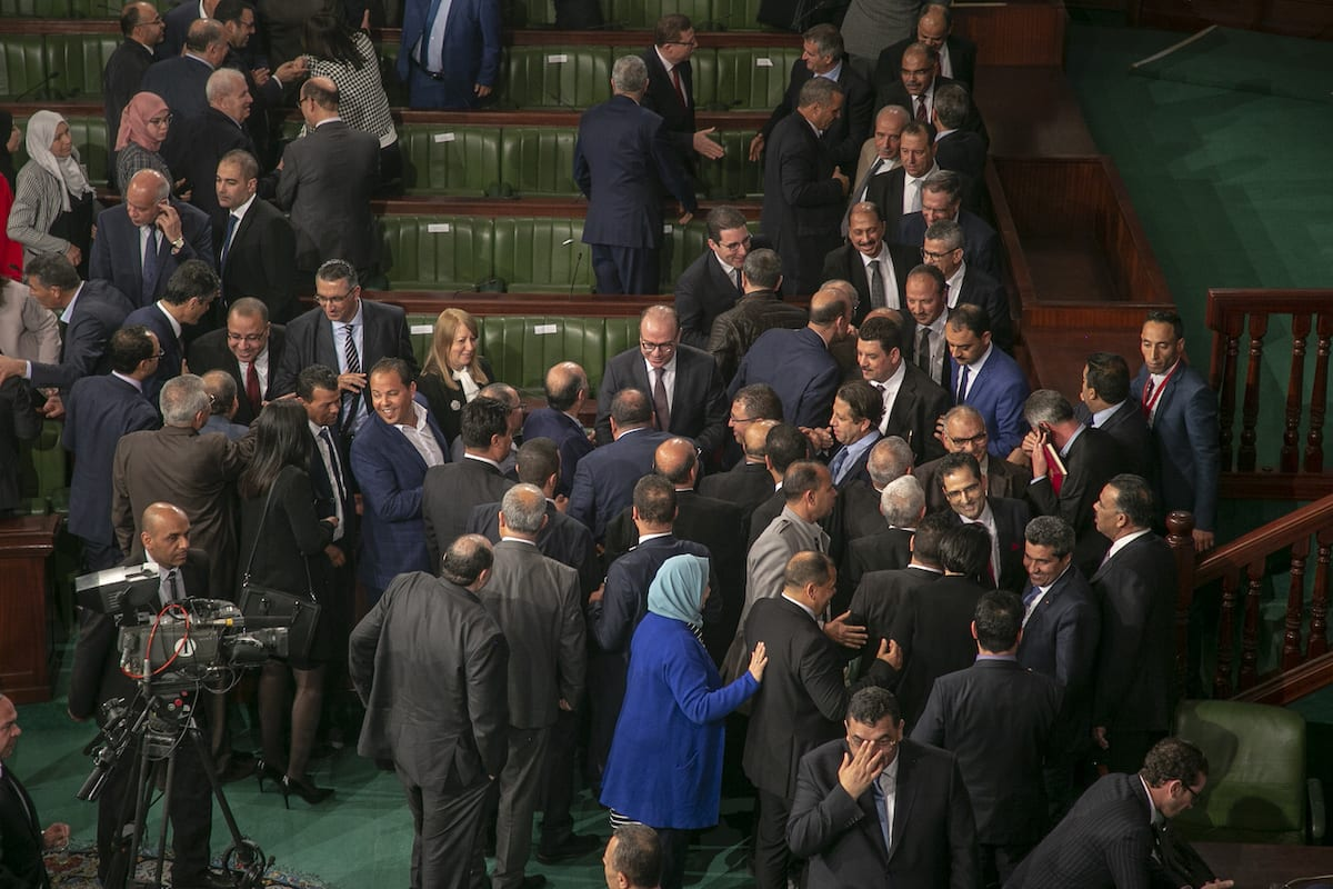 Members of the Tunisian parliament congratulate Elyes Fakhfakh after new coalition government is approved in Tunis, Tunisia on 27 February 2020. [Yassine Gaidi - Anadolu Agency]