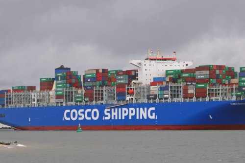 A container ship of the Chinese shipping company Cosco, seen near the Port of Rotterdam on September 8, 2017 [kees torn / Wikipedia]