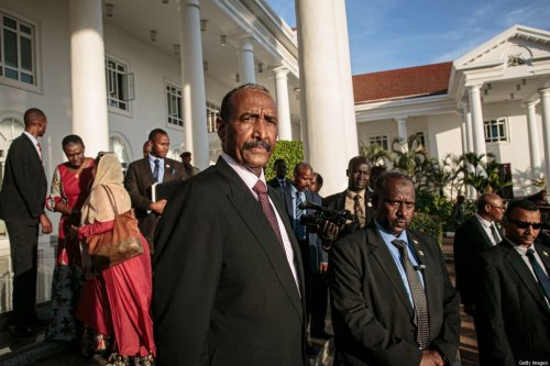 President of Sudan's Transitional Council Abdel Fattah al-Burhan (C) stands as he leaves after talks on South Sudan's proposed unity government at State House in Entebbe on November 7, 2019 [MICHAEL O'HAGAN/AFP via Getty Images]