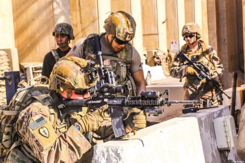 A handout picture received from the US embassy in Iraq on December 31, 2019, shows American soldiers taking position around the embassy in the capital Baghdad, after supporters and members of the Hashed al-Shaabi military network breached the outer wall of the diplomatic mission during a rally to vent anger over weekend air strikes that killed pro-Iran fighters in western Iraq [US EMBASSY IN IRAQ/AFP via Getty Images]