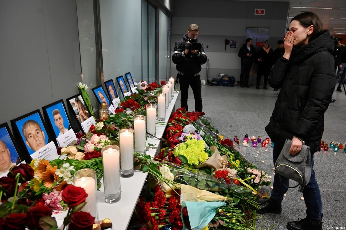 A woman reacts in front of a memorial for the victims of the Ukraine International Airlines Boeing 737-800 crash in the Iranian capital Tehran, at the Boryspil airport outside Kiev on January 8, 2020. - A Ukrainian airliner crashed shortly after take-off from Tehran Wednesday killing all 176 people on board, in a disaster striking a region rattled by heightened military tensions. (Photo by Sergei SUPINSKY / AFP) (Photo by SERGEI SUPINSKY/AFP via Getty Images)