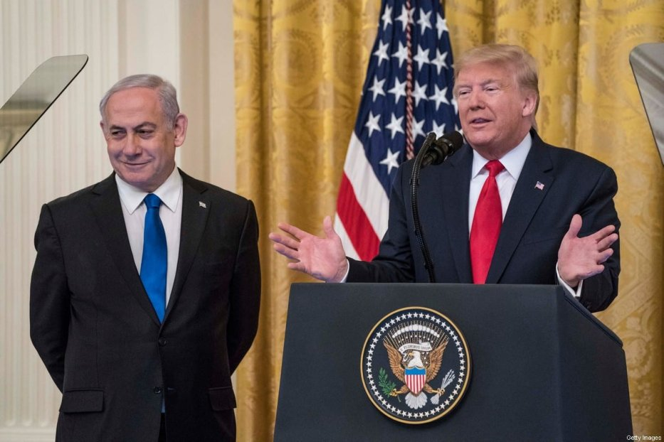 US President Donald Trump andIsraeli Prime Minister Benjamin Netanyahuparticipate in a joint statement in the East Room of the White House on 28 January 2020 in Washington, DC. [Sarah Silbiger/Getty Images]