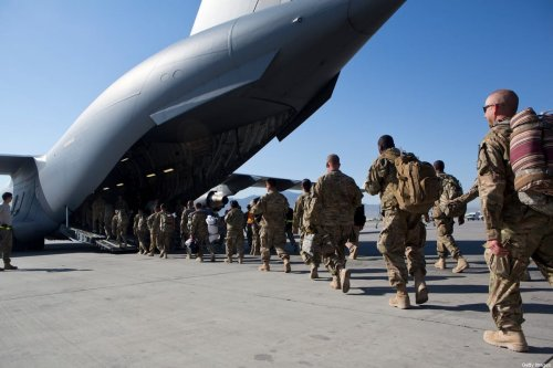 US Army soldiers walk to their C-17 cargo plane for departure May 11, 2013 at Bagram Air Base, Afghanistan [Robert Nickelsberg/Getty Images]