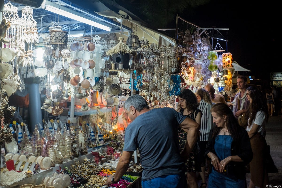 Tourists shop at a street market on 15 September, 2017 in Bodrum, Turkey [Chris McGrath/Getty Images]