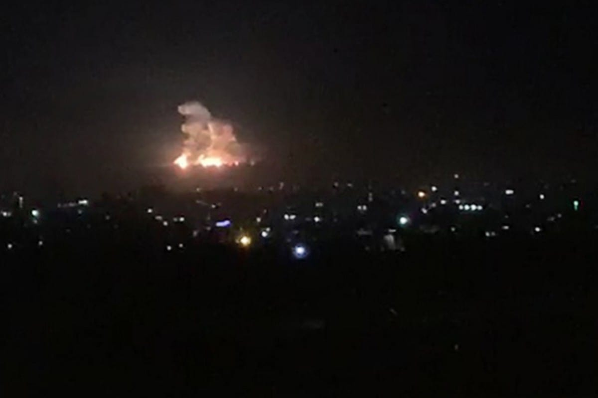 An image grab shows smoke and fire billowing during a Israeli air strike on the outskirts of Damascus [AFP/Getty Images]
