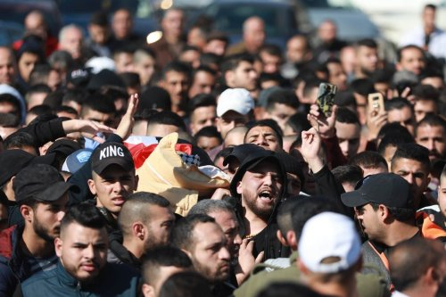 People carry the dead body of 19-year-old Yazan Abu Tabikh, who succumbed to his wounds after Israeli forces shot him in Jenin, West Bank on 6 February 2020 [Issam Rimawi/Anadolu Agency]
