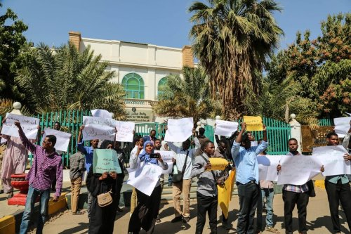 Protesters hold placards during a protest against meeting of Sudan's Sovereign Council Head Abdel-Fattah Al-Burhan and Prime Minister of Israel Benjamin Netanyahu, in front of Prime Ministry building in Khartoum, Sudan on 4 February, 2020 [Mahmoud Hajaj/Anadolu Agency]