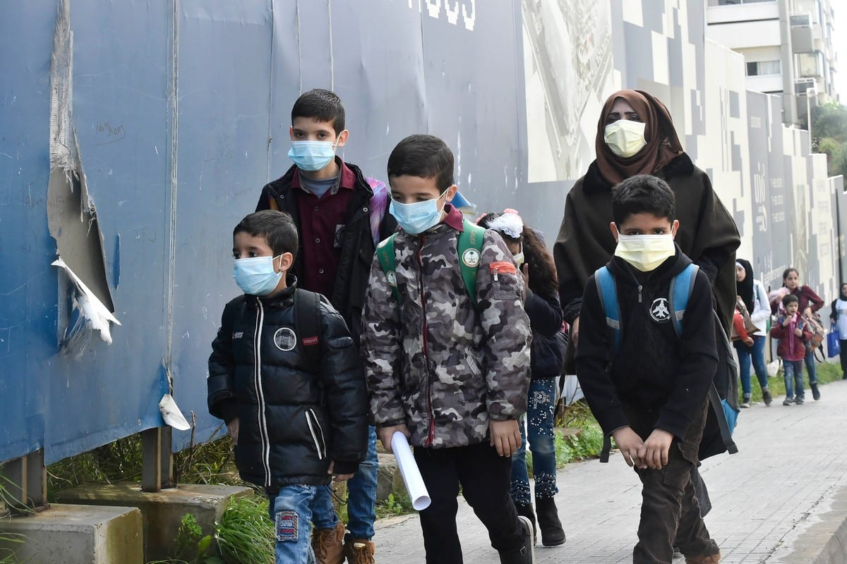 Students wear masks to protect themselves from coronavirus as a precaution in Beirut, Lebanon on 22 February 2020 [Hussam Chbaro/Anadolu Agency]
