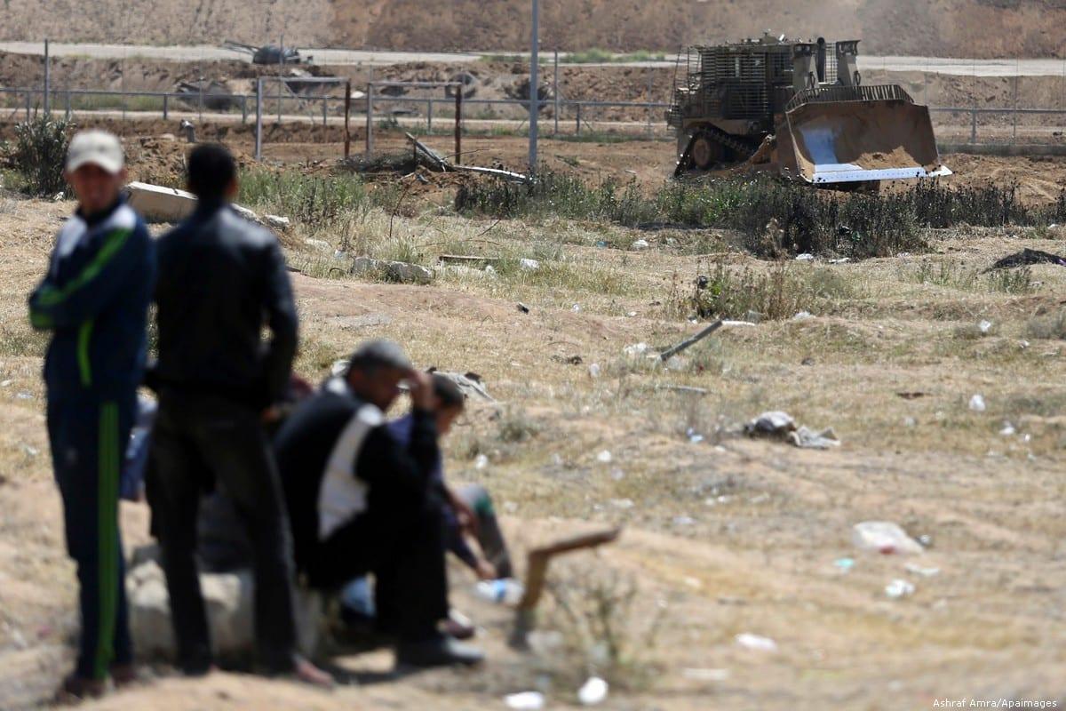 Israeli bulldozers seen at at the Gaza-Israel fence, on 11 April 2018 [Ashraf Amra/Apaimages]