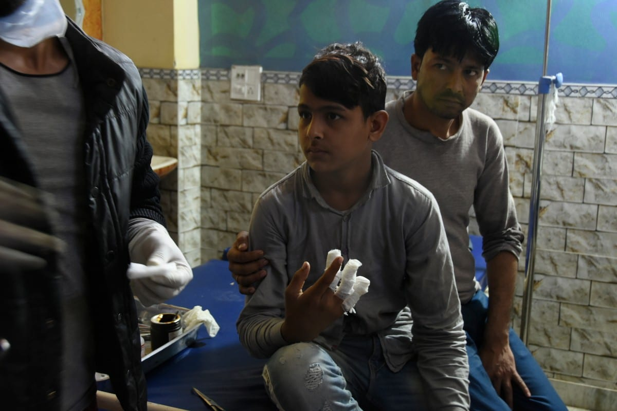 An injured boy is being treated at a hospital in New Mustafabad, following the Citizenship Amendment Act (CAA) clashes in Delhi, India on 26 February 2020 [Javed Sultan/Anadolu Agency]