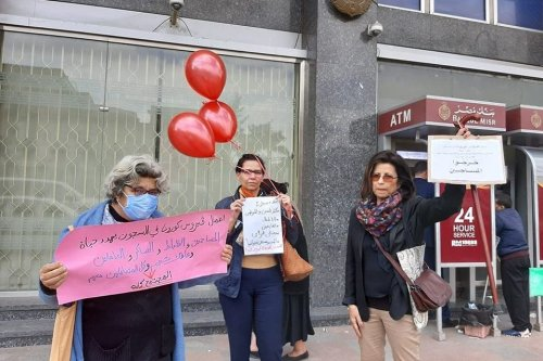 Egyptian writer Ahdaf Soueif (R), academic Rabab El-Mahdi (C) and human rights activist Laila Soueif (L) protest demanding the release of Egypt's political detainees amid coronavirus outbreak [Facebook]