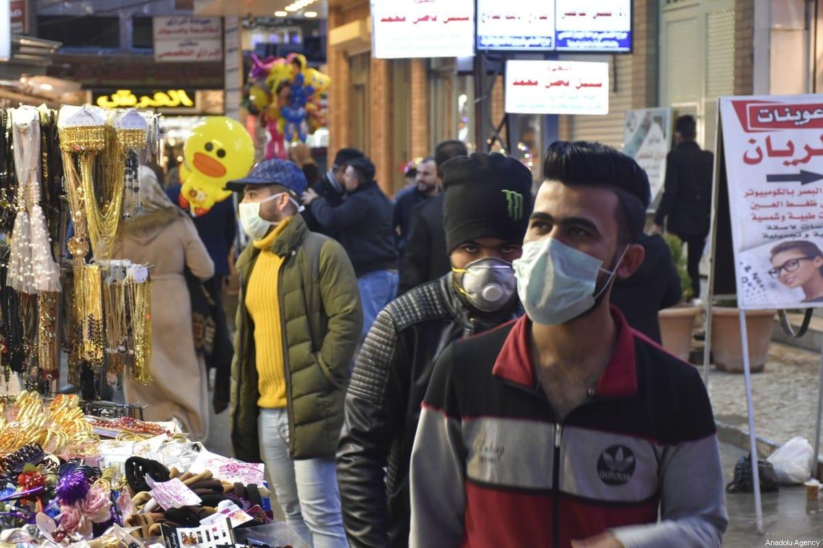 People wear medical masks as a precaution to protect themselves from coronavirus in Kirkuk, Iraq on 25 February 2020 [Ali Makram Ghareeb/Anadolu Agency]