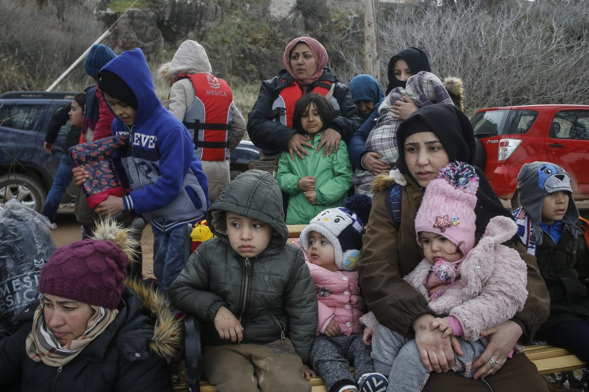 Irregular migrants escaped from civil war in Syria, who want to proceed to Europe, are seen after they came with a boat at a shore in Lesbos Island on Greece on 28 February, 2020 [Ayhan Mehmet/Anadolu Agency]