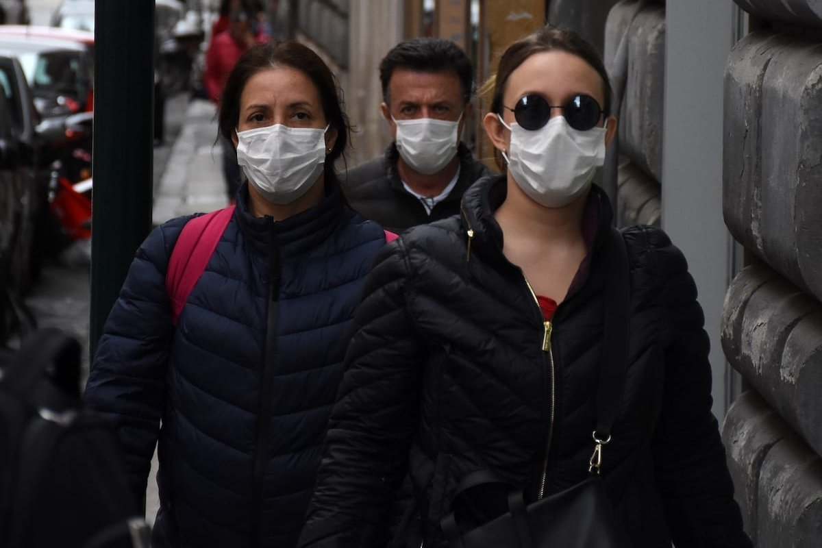People wearing medical face masks are seen in the streets of Rome as the death toll from an outbreak of coronavirus, officially known as COVID-19 climbs to 52 in Italy on 2 March 2020. [ Barış Seçkin - Anadolu Agency]