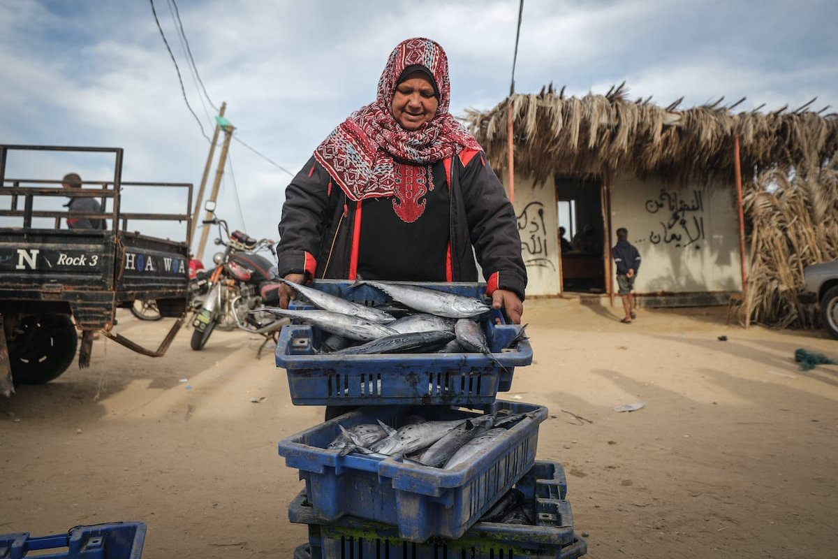 UM Cemil Aqra, a 57-year-old Palestinian woman is seen selling fish to contribute to her family budget in Khan Yunis, Gaza on 7 March 2020. Ali [Jadallah - Anadolu Agency]