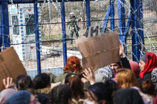 Asylum seekers wait to enter Greece at Pazarkule border crossing in Turkey's Edirne on 8 March 2020 [Elif Öztürk/Anadolu Agency]