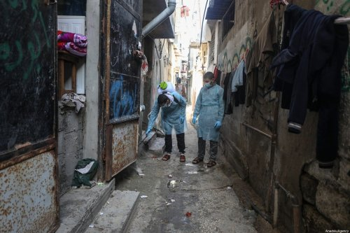 A volunteer group linked to Hamas carries out disinfection work as a precaution against the coronavirus (COVID-19) at the streets of Al-Shati Camp in Israeli blockaded Gaza City, Gaza on March 16, 2020 [Ali Jadallah - Anadolu Agency]