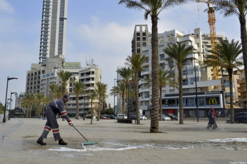 Workers clean the streets as a preventive measure against coronavirus (Covid-19) in Beirut, Lebanon on 16 March 2020 [Hussam Chbaro/Anadolu Agency]
