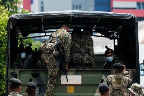Malaysian security forces in Kuala Lumpur, Malaysia on 22 March 2020 [Syaiful Redzuan /Anadolu Agency]