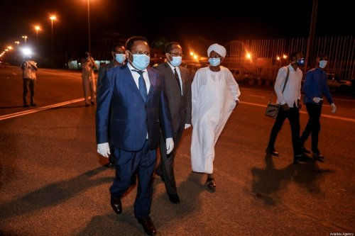 Sudanese Health Minister Akram El Tom (2nd L) is seen as Ethiopian Airline plane load of protective and medical equipment donated by Chinese businessman Jack Ma, lands at Khartoum International Airport in Sudan on March 23 2020. [Mahmoud Hjaj - Anadolu Agency]