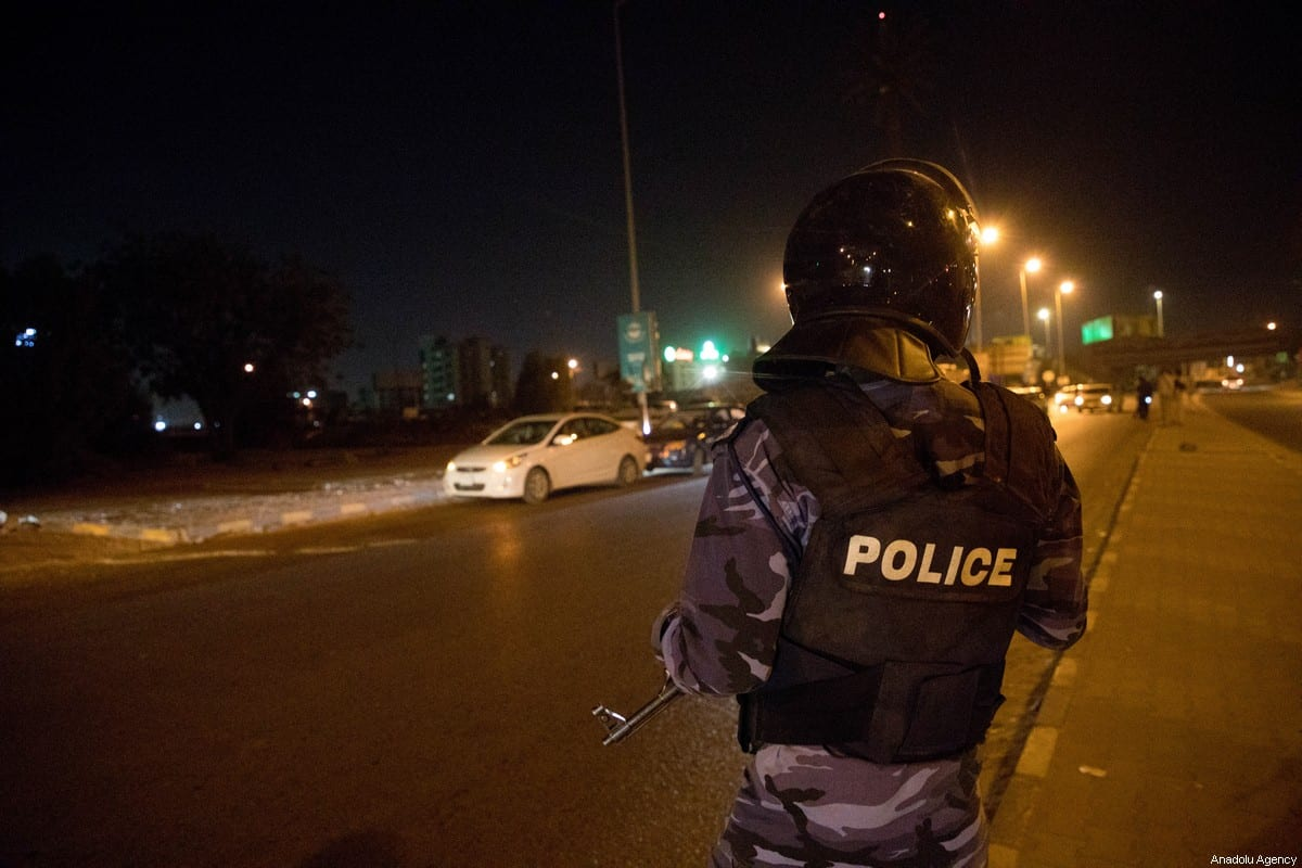 Police take measurements at a street due to the partial curfew imposed as a precaution against coronavirus (COVID -19) in Khartoum, Sudan on March 24, 2020. Sudan impose a partial curfew as part of efforts to curb the spread of the novel coronavirus, an official said Monday. [Mahmoud Hjaj - Anadolu Agency]