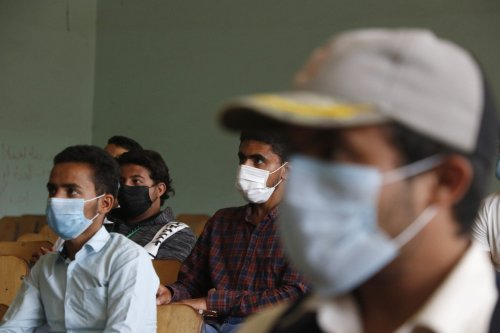 A group of volunteers wearing face masks are being educated at Sanaa University in preparation against the coronavirus (COVID-19) pandemic in Sanaa, Yemen on 28 March 2020 [Mohammed Hamoud/Anadolu Agency]
