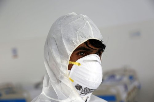 A Yemeni man in protective clothing at a hospital for coronavirus patients in Sanaa, Yemen on 28 March 2020 [Mohammed Hamoud/Anadolu Agency]