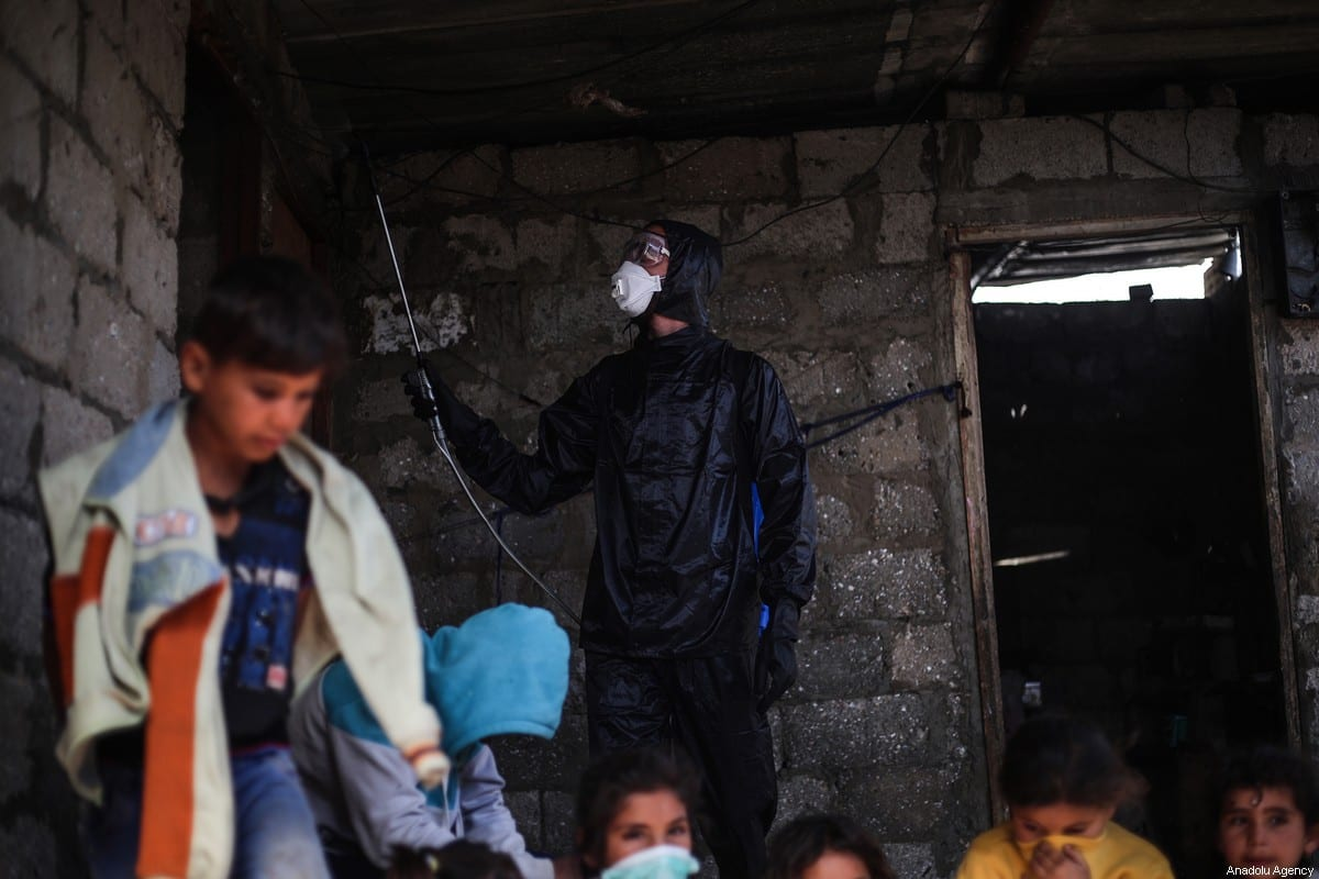 A group of volunteer youth carry out disinfection work during the coronavirus pandemic in Gaza on 29 March 2020 [Mustafa Hassona/Anadolu Agency]