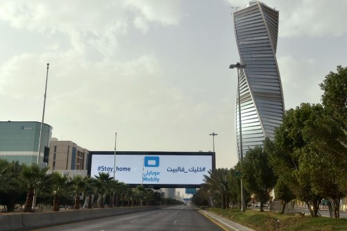 A picture taken on March 26, 2020, shows a huge A billboard which says 'Stay Home' in the Saudi capital Riyadh [FAYEZ NURELDINE/AFP/Getty Images]