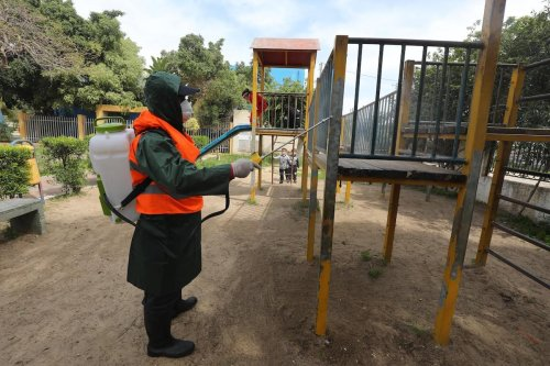 Palestinian workers spray disinfectant as a precaution to prevent the spread of the coronavirus, in Gaza, on 9 March 2020 [Mohammed Asad/Middle East Monitor]