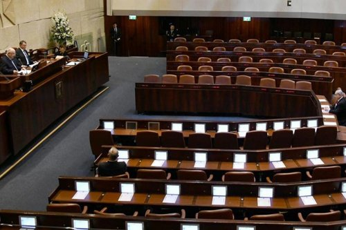 Israeli MPs took oaths in groups of threes as a preventive measure against the coronavirus (Covid-19), leaving many seats empty throughout the Knesset session on 16 March 2020 [Mark Neyman/Anadolu Agency]