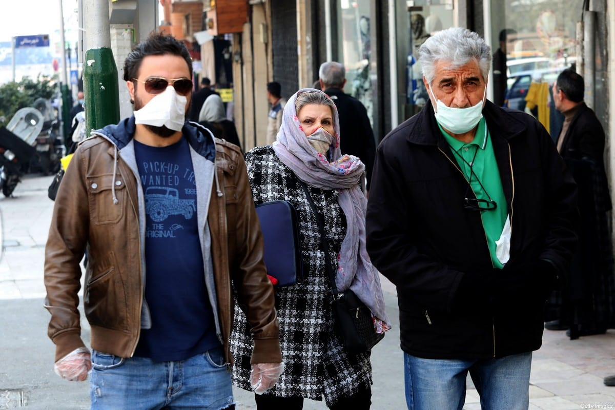 Mask-clad pedestrians walk through Tajrish Bazaar in the Iranian capital Tehran on 29 February 2020 [ATTA KENARE/AFP/Images]