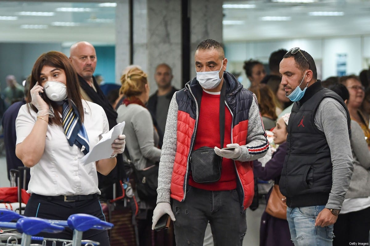 Passengers stranded at Tunis Carthage airport wait for flights on 16 March, 2020 [FETHI BELAID/AFP via Getty Images]