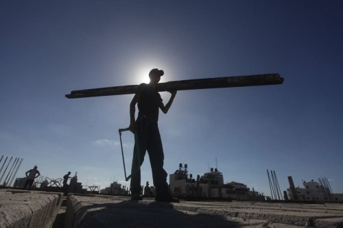 A construction worker can seen at a building site, 16 September 2013 [Ashraf Amra/ApaImages]