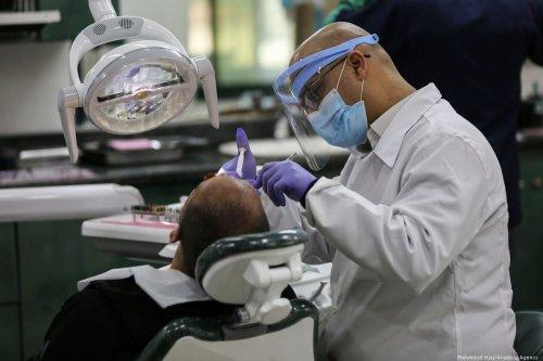 A Palestinian doctor performs a medical examination to detect Coronavirus Gaza on 10 March 2020 [Ashraf Amra/ApaImages]