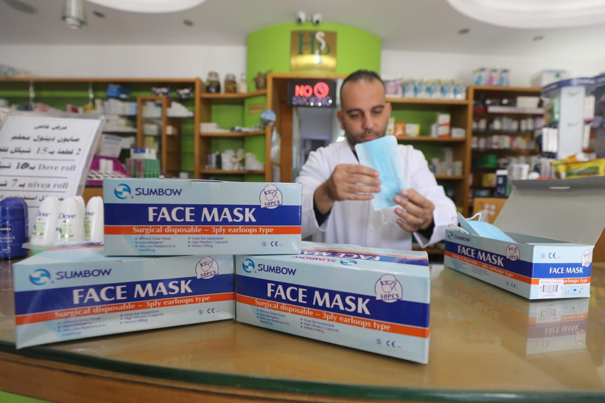 A pharmacy in Gaza stock up on face masks due to the coronavirus outbreak, 7 March 2020 [Mohammed Asad/Middle East Monitor]