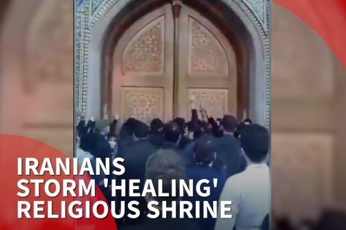 Iran: Crowds storm 'healing' religious shrine
