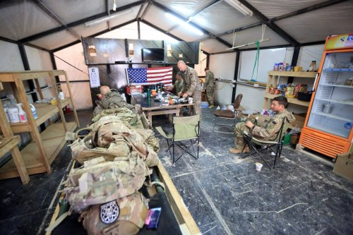 Soldiers from the US-led coalition forces are seen at the Al-Qaim Military Base in Iraq's Anbar province, west of Baghdad, on 19 March 2020 [Murtadha Al-Sudani/Anadolu Agency]