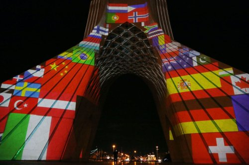Azadi tower is illuminated with the flags of countries struggling against coronavirus (COVID-19) pandemic in Tehran, Iran on 31 March 2020 . [Fatemeh Bahrami - Anadolu Agency]
