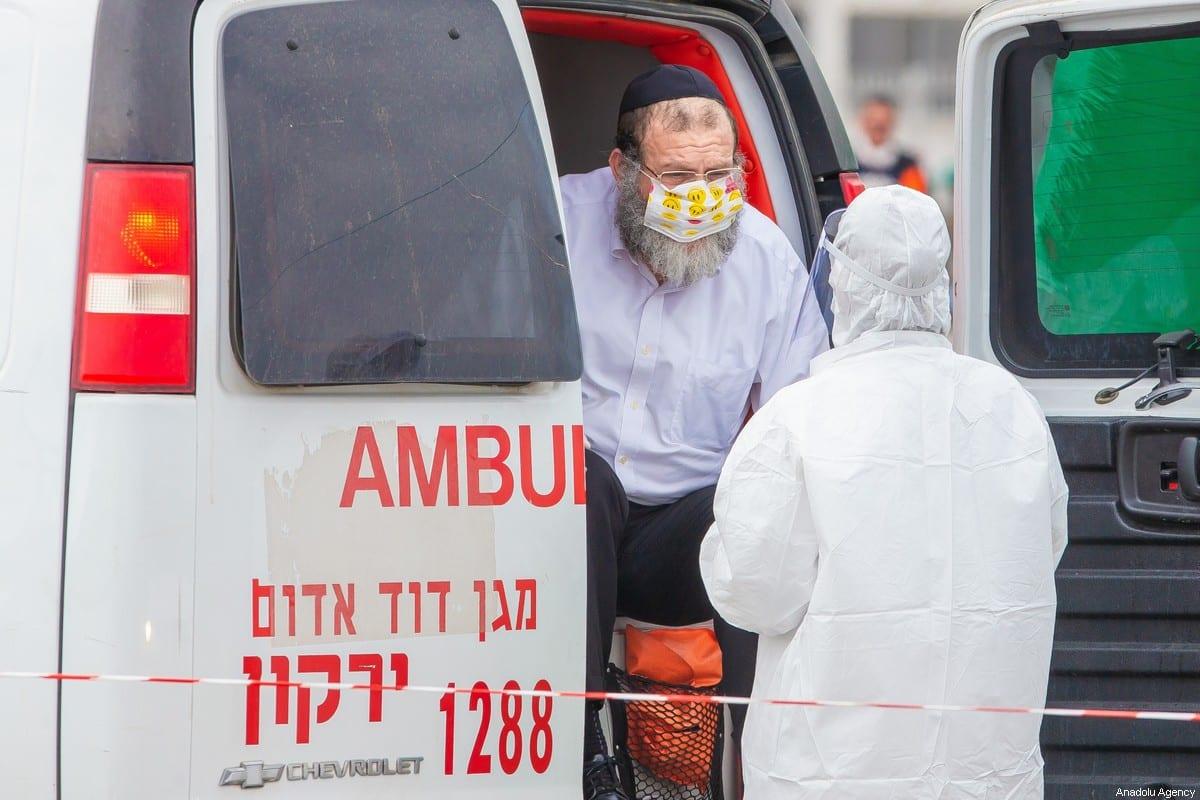 A health officer checks a citizen in ambulance as a precaution against coronavirus (Covid-19) in Tel Aviv, Israel on 3 April 2020. [Nir Keidar - Anadolu Agency]