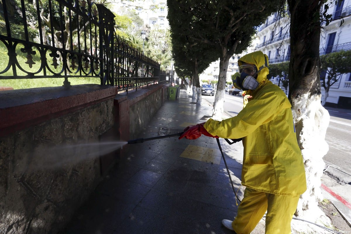 Officials carry out disinfection works as part of coronavirus (COVID-19) precautions in Algiers, Algeria on 4 April 2020 [Farouk Batiche/Anadolu Agency]