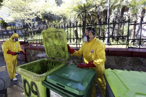 Officials carry out disinfection works as part of coronavirus (COVID-19) precautions in Algiers, Algeria on 4 April, 2020 [Farouk Batiche/Anadolu Agency]