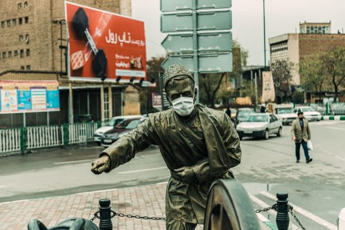 A statue with face mask is seen after Iranian government gradually remove the precautions against the novel coronavirus (Covid-19) pandemic leading shops to re-open in Tabriz, Iran on 12 April 2020. [Stringer - Anadolu Agency]