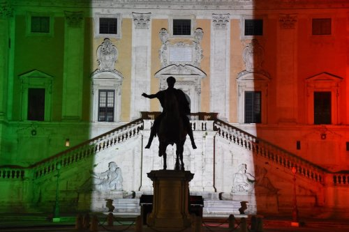 Rome's Municipal building is illuminated with the colours of the Italian national flag to show the fight against the new type of coronavirus (COVID-19) pandemic to curb at Campidoglio Square in Rome, Italy on 12 April 2020. [Barış Seçkin - Anadolu Agency]