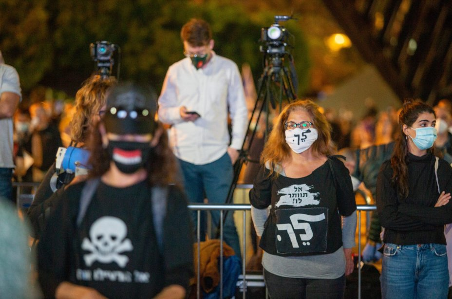 Israelis, wearing protective face masks due to the novel coronavirus (COVID-19) pandemic and keeping social distance, gather to protest against Prime Minister Benjamin Netanyahu at Rabin Square in Tel Aviv, Israel on April 19, 2020 [Nir Keidar - Anadolu Agency]